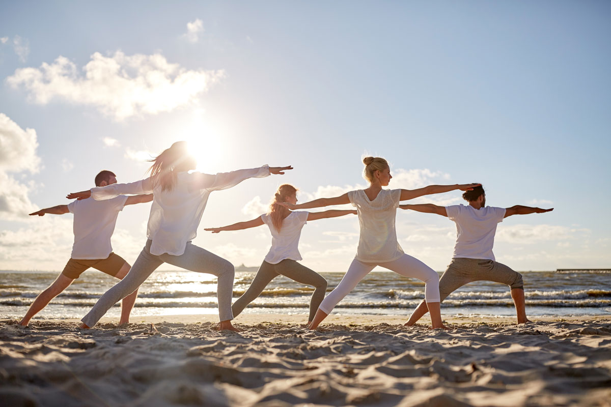 Group on beach doing Sadhana Kundalini Yoga