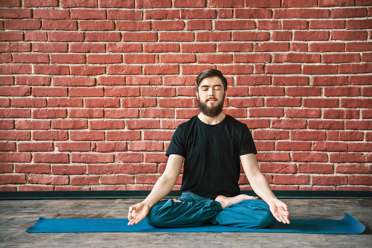 Man with beard practising Suspending the Breath Kundalini Yoga Meditation