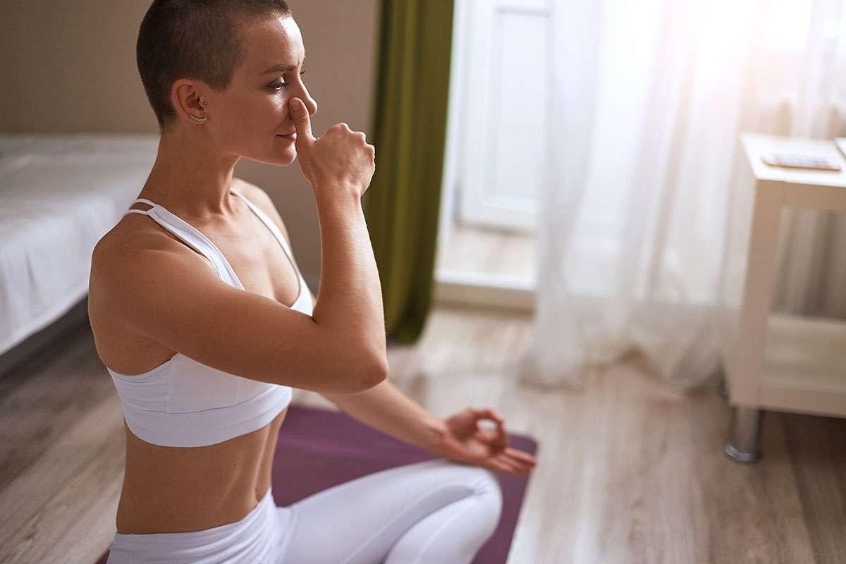 Girl practises Kundalini Yoga Nostril Breathing