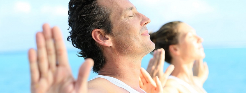 Guy and Girl Practicing Venus Kriyas for Kundalini Yoga