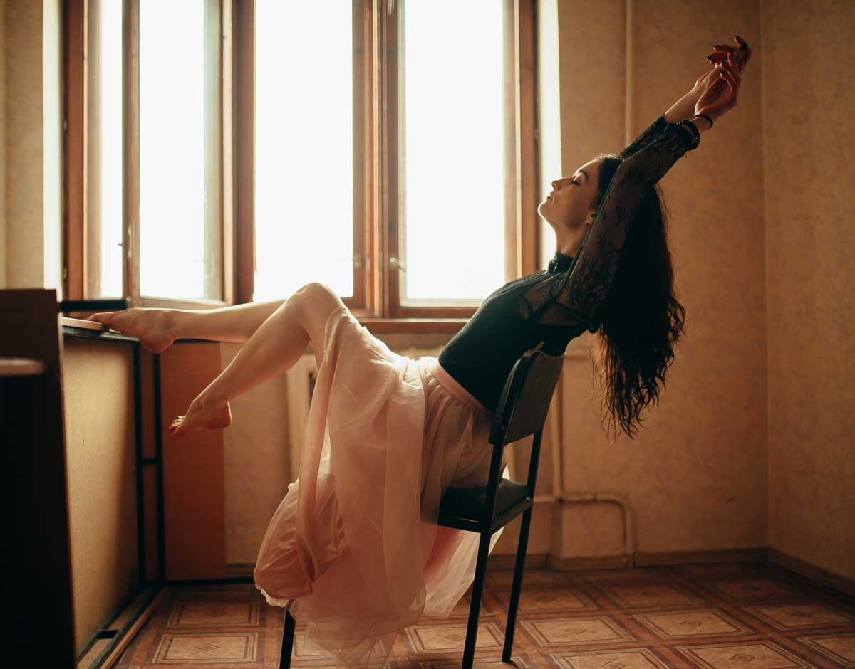 Woman stretches on chair