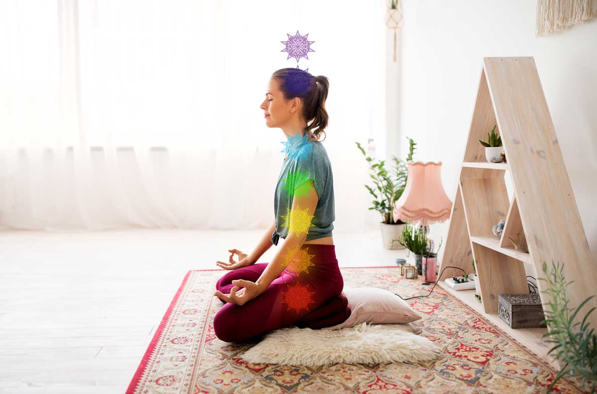 Woman sits in lotus pose