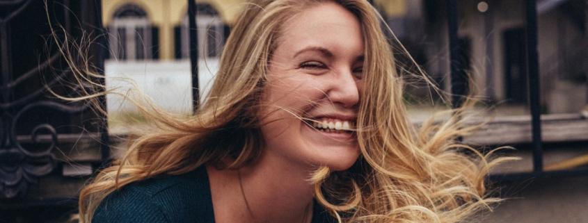 Woman smiling, looking joyful