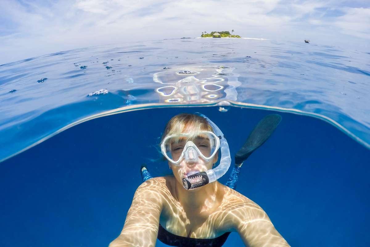 Woman snorkelling underwater