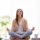 Woman sits cross-legged meditating