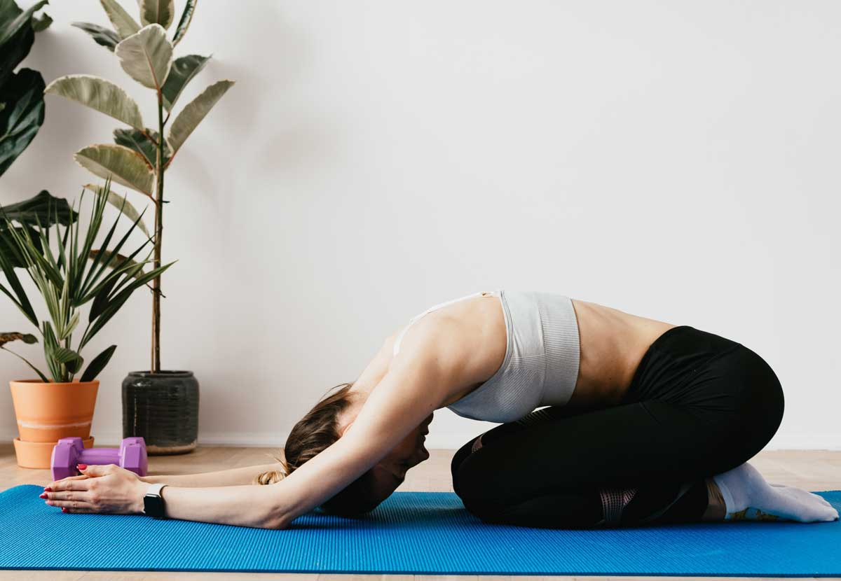 Woman practicing child pose